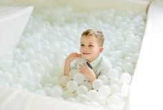 Toddler boy in pool Stock Photos