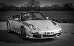 Toddler boy in Porsche car with father Royalty Free Stock Photos