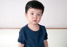 Toddler boy portrait. Asian toddler boy blue shirts Royalty Free Stock Photo