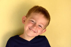 Toddler boy. Portrait of a  mischievously toddler boy with blond hair Stock Photos