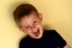 Toddler boy. Portrait of a  mischievously toddler boy with blond hair Royalty Free Stock Photo