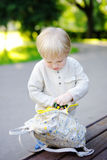Toddler boy putting toys in backpack Stock Photos