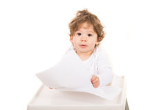 Toddler boy reading paper Stock Images
