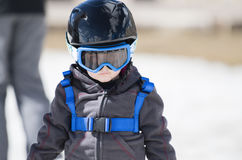Toddler Boy Ready to Ski with all Safety Gear. Helmet & Harness. stock photos