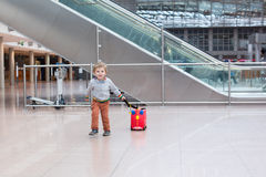 Toddler boy with red child suitcase at airport Royalty Free Stock Images