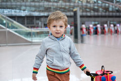 Toddler boy with red child suitcase at airport Stock Photography