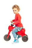 Toddler boy riding bicycle Stock Photos