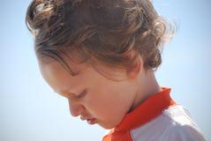 Toddler boy side profile outside Royalty Free Stock Photo