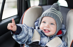 Toddler  boy sitting in the car seat Stock Images