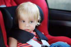 Toddler boy sitting in car seat Royalty Free Stock Photography