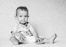 Toddler boy sitting considering the book Royalty Free Stock Image
