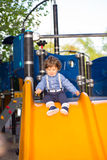 Toddler boy on slide Stock Photo
