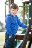 Toddler Boy Smiling on a Climbing Frame Royalty Free Stock Photo