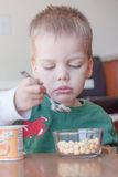 Toddler boy snacking Royalty Free Stock Photography