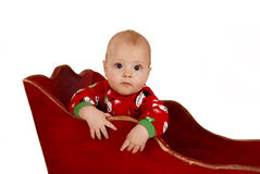 Toddler boy in snowman pajamas in a sleigh Royalty Free Stock Photography