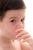Toddler Boy Sucking his Thumb. Headshot of a caucasian Toddler Boy, brown hair with big blue eyes, showing insecurity and bad health habits by sucking his thumb Royalty Free Stock Image