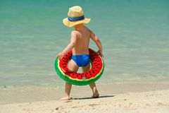 Toddler boy with swim ring on beach. Two year old toddler boy with inflatable swim ring on beach Stock Photo