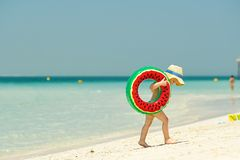 Toddler boy with swim ring on beach. Two year old toddler boy with inflatable swim ring on beach Stock Image