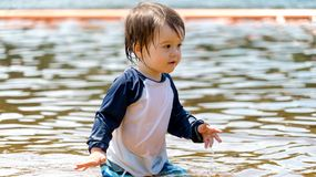 Toddler boy swimming on a summer day Stock Image