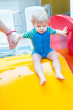 Toddler boy swimming, having fun and playing in water Stock Images