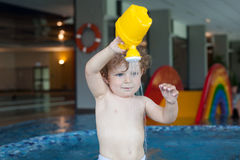 Toddler boy swimming, having fun and playing in water Royalty Free Stock Images