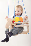 Toddler boy in swing Royalty Free Stock Image