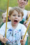 Toddler boy on a swing stock image