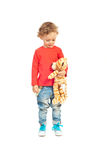 Toddler boy talking with tiger toy Stock Photography