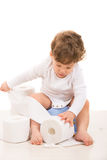 Toddler boy tear toilet paper Royalty Free Stock Images