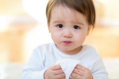 Toddler boy with a tissue stock photos