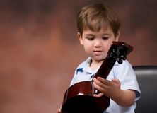 boy loves ukelele Royalty Free Stock Photography