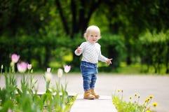 Toddler boy walking in the garden Royalty Free Stock Image