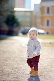 Toddler boy walking outdoors Stock Photos