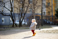 Toddler boy walking outdoors at the spring day Stock Images