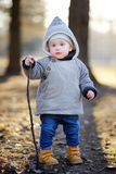 Toddler boy walking outdoors at the spring day Stock Photo