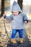 Toddler boy walking outdoors at the spring day Stock Photos