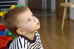 Toddler boy watches TV Stock Photo