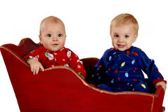 Toddler boys in Christmas pajamas happy Royalty Free Stock Image