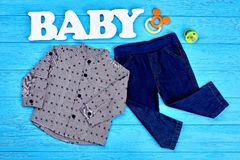 Toddler boys fashion clothes background. Baby-boy grey dotted shirt and dark blue denim jeans. Little boy autumn clothes and accessories stock photography