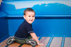 Toddler boys plays in blue truck bed Stock Photo