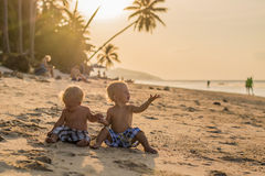 Toddler Boys Sitting on the beach Royalty Free Stock Photo