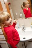 Toddler brushing her teeth Stock Photography