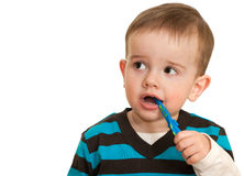 Toddler is brushing his teeth Stock Images