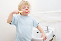 Toddler brushing his teeth Royalty Free Stock Photo
