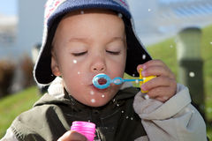 Toddler with bubble wand Stock Image