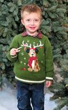 Toddler and Candy Cane. Image of a toddler and candy cane royalty free stock photography