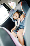 Toddler in   car seat Stock Images