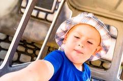 Toddler on a carousel Stock Photos