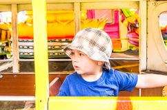 Toddler on a carousel Royalty Free Stock Photo