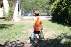 Toddler carrying his milk from farm Royalty Free Stock Photo